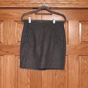 gray skirt, back zipper, front zip pockets